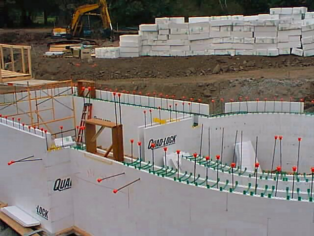 Photos of residential icf construction using quad lock for Concrete basement forms
