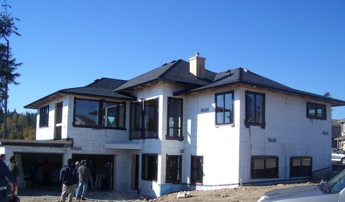 Photos of residential icf construction using quad lock for Exterior house finishes